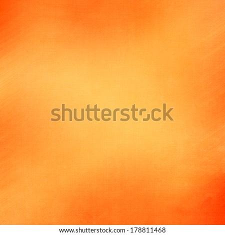 abstract orange background light yellow corner spotlight, faint dark orange vintage grunge background texture orange paper layout design for warm colorful background, rich bright hot sunny color  - stock photo