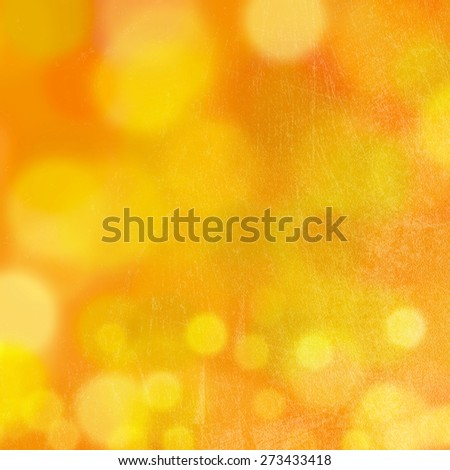 Abstract orange background with yellow bokeh. Summer background. - stock photo