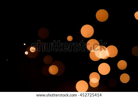 abstract orange bokeh in black back ground