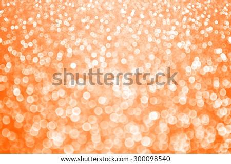 Abstract orange glitter sparkle bokeh background Halloween Autumn or holiday party invite - stock photo