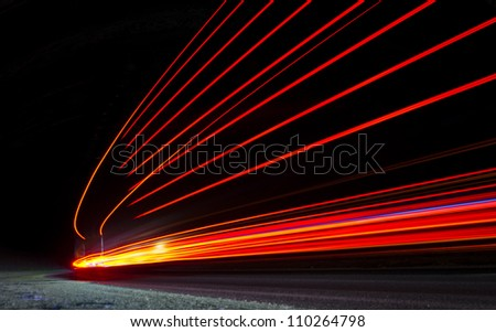 Abstract orange lights in perspective in a road tunnel - stock photo