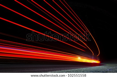 Abstract orange, red and yellow lights in road tunnel that can be used as background or texture - stock photo
