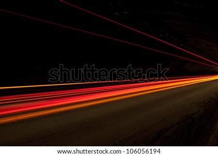Abstract orange, red and yellow lights in road tunnel that can be used as texture or background