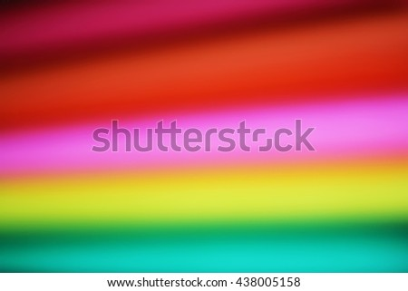 Abstract paper stack defocused colourful background. Paper stack of different colors defocused