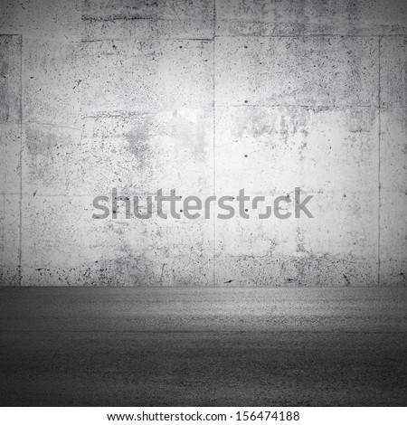 Abstract parking interior fragment with concrete wall and asphalt ground - stock photo