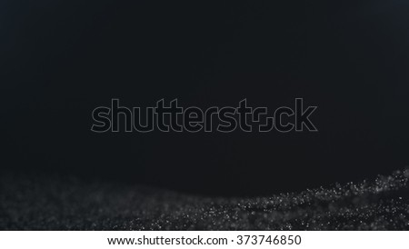 Abstract particle background with shallow depth of field at the top and bottom of the screen. See my portfolio for more colors - stock photo