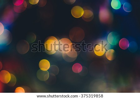 Abstract party lights on dark background - stock photo