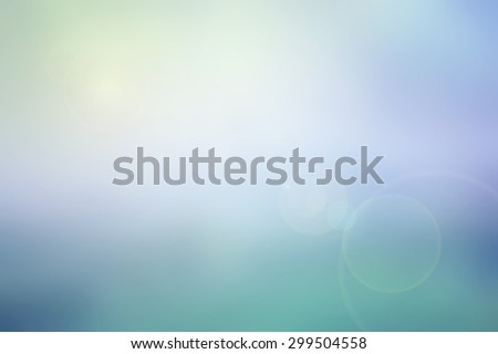 Abstract pastel sky blurred background in colorful tone (blue, violet, turquoise and yellow) with bright sunlight and flare, use for backdrop or web design in summer concept - stock photo