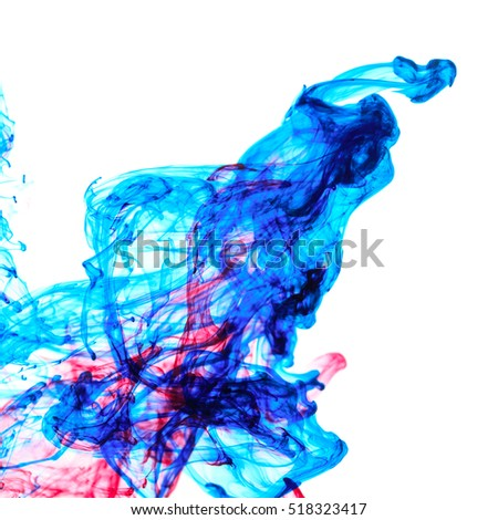 Abstract pattern falling into the water drop of red and blue ink
