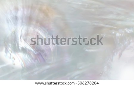 Abstract pearl background with shimmering mother of pearl lilac and rainbow colours