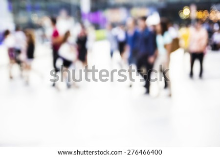 Abstract people are walking in the city. Blurred background. - stock photo