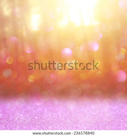 abstract photo of light burst among trees and glitter bokeh . image is blurred and filtered .