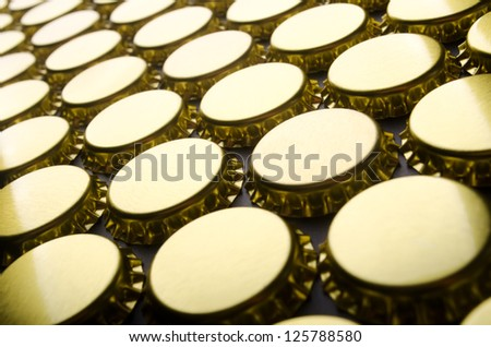 Abstract photo of new metallic crown caps - stock photo