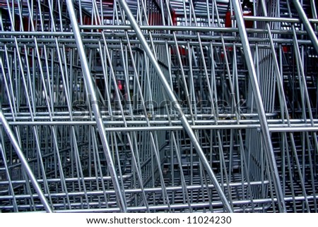 Abstract photograph featuring stacked shopping trolleys (Adelaide, Australia). - stock photo