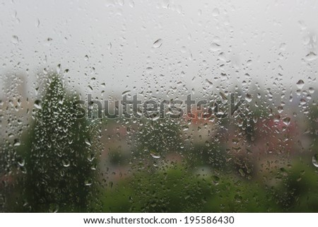 Abstract picture of raindrops on the window - stock photo