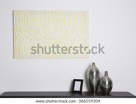 Abstract picture with vases and frame on a white wall background - stock photo