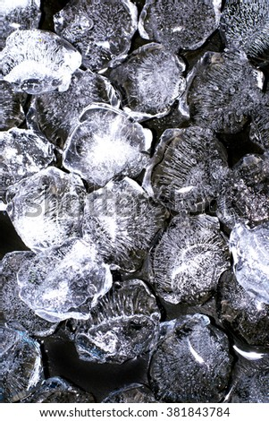 Abstract pieces of crushed ice on black background - stock photo