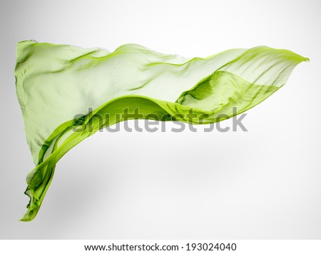 abstract pieces of green fabric flying, high-speed studio shot - stock photo