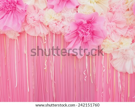 Abstract pink fabric paper craft flower for decoration background - stock photo