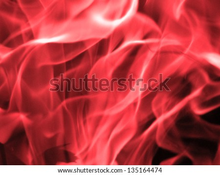 Abstract pink flame isolated on black - stock photo