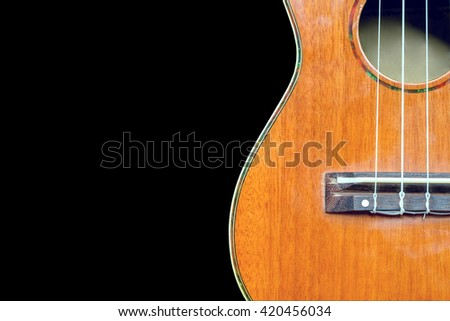 abstract portrait of a ukulele isolated on black background. with clipping path
