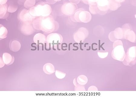 Abstract purple bokeh light background - stock photo
