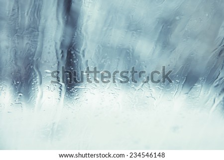 Abstract rainy and snowy car window background.  - stock photo