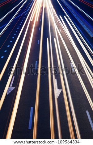 Abstract Real Traffic Road Background / High traffic road with automobile light trails in a rush-hour - stock photo