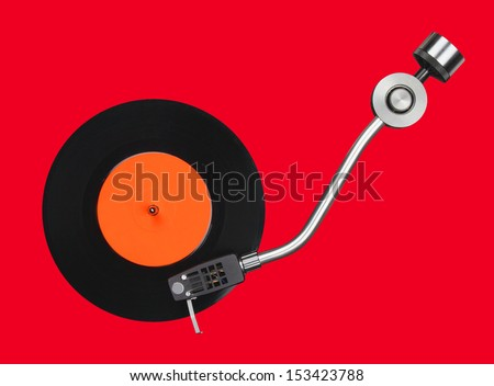 Abstract record player part isolated on red - stock photo