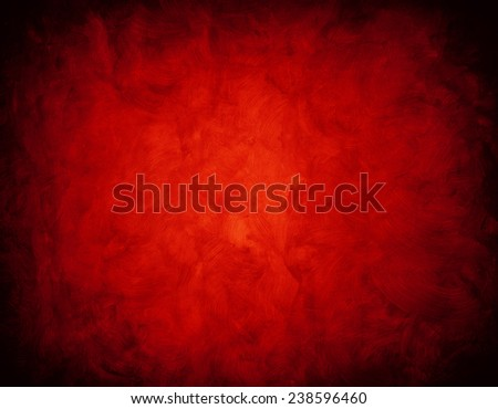 abstract red background or Christmas paper with bright center spotlight and black vignette border frame. - stock photo