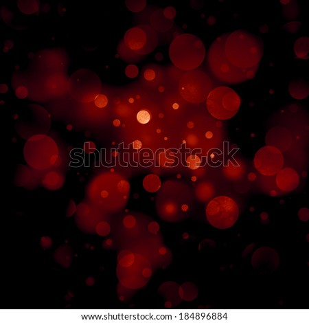 abstract red background, red bubble lights on black background or snowflakes falling at night. Bokeh Christmas background with circle designs or blurred stars shining, glitter magic background - stock photo
