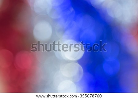 Abstract red blue and white bokeh background of tinsel, blurred by camera - stock photo