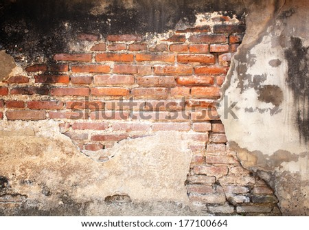 Abstract red brick wall of old decaying erosion. - stock photo