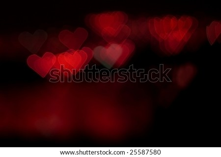 Abstract red colored heart bokeh background - stock photo