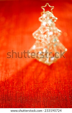 abstract red flaring background with tin focus line in front and glitter christmas tree decoration defocused bokeh - stock photo