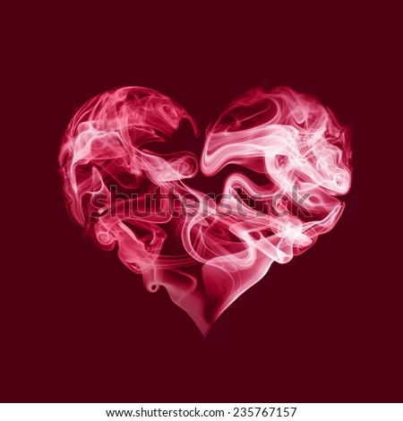 Abstract red heart from smoke on red background