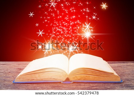 Abstract red magic book on wooden background