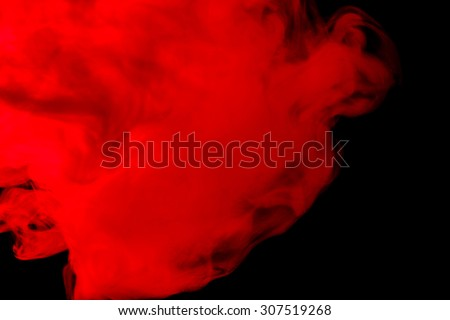 Abstract red-orange hookah smoke on a black background. Photographed using a gel filter. Texture. Design element. - stock photo