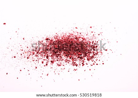 abstract red powder splatted on white background