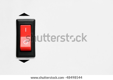 Abstract Red power switch mounted on front side of electronics device - stock photo
