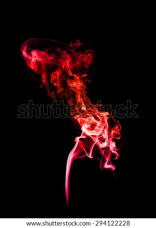 Abstract red smoke on black background.