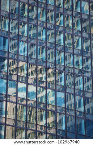 Abstract reflection in windows of a modern office building - stock photo