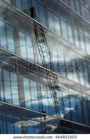abstract reflection of crane and blue sky
