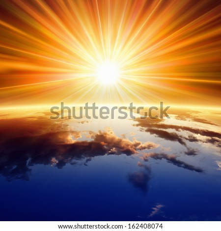 Abstract religious backgrounf - bright sun shines above planet Earth - stock photo