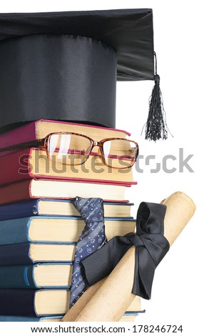 Abstract representation of the student: books, eyeglasses, mortarboard - stock photo