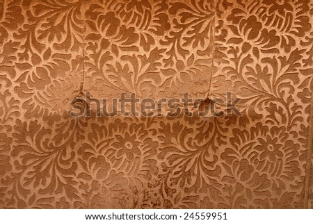 abstract retro golden velvet textile detail with buttons from couch