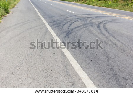 Abstract road background with tracks of tires.