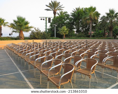 Abstract row of chair seats in open air theater - stock photo
