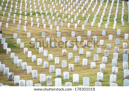 Abstract rows of gravestones honoring US veterans at Fort Rosecrans National Cemetary at Point Loma in San Diego, California