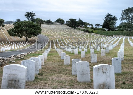 Abstract rows of gravestones honoring US veterans at Fort Rosecrans National Cemetary at Point Loma in San Diego, California - stock photo